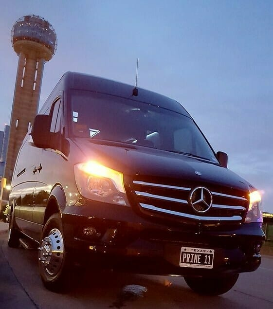 Front of black Sprinter with Dallas Reunion Tower in background