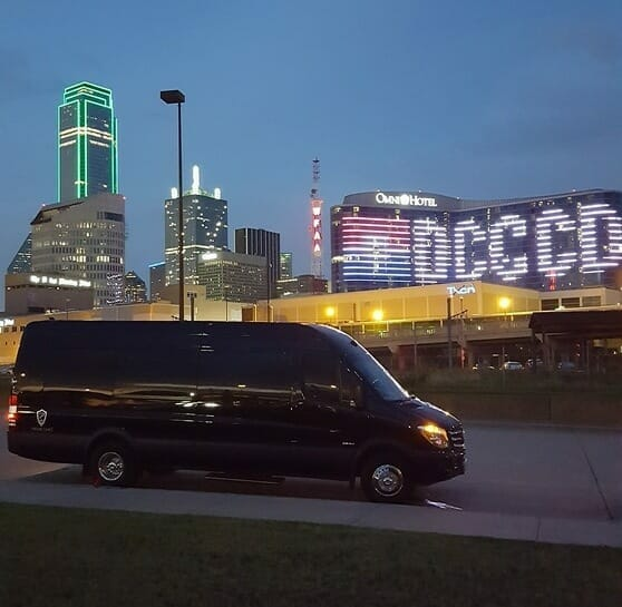 Side of black Sprinter with Omni displaying DCCCD at night