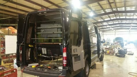 The trunk of our black Sprinter limo in the process of being built