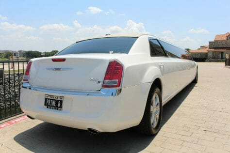 Back picture of Chrysler 300 limo during the day