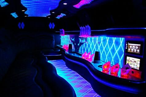 Interior of Chrysler 300 limo with blue lights